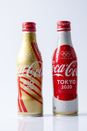 caffeine free: KUALA LUMPUR- MARCH 19, 2017: Coca-Cola world cups cans. Coca-cola is the worlds most selling carbonated soft drink Editorial