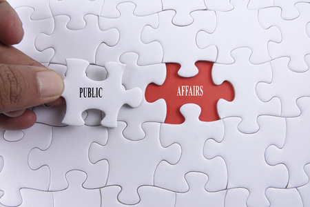 Jigsaw puzzle with PUBLIC AFFAIRS conceptual words.