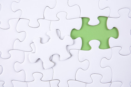 Missing piece of puzzle on white background