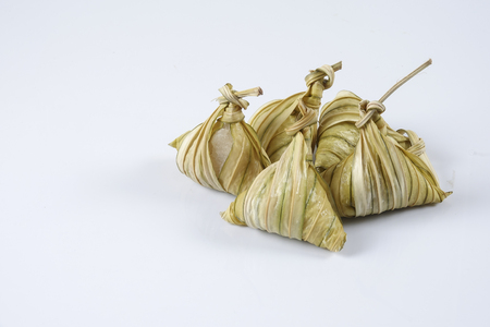 Malay dish ketupat daun palas or rice dumpling where glutinous rice is wrapped in a triangular shape using the leaves of the fan palm Stock Photo