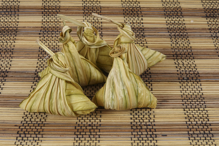 weave: Malay dish ketupat daun palas or rice dumpling where glutinous rice is wrapped in a triangular shape using the leaves of the fan palm Stock Photo