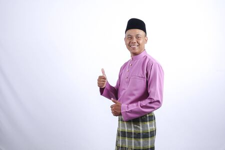 Man in traditional clothing, standing  celebrate Eid Fitr.