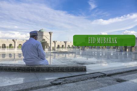 devote: EID MUBARAK concepts word with background of muslim model.