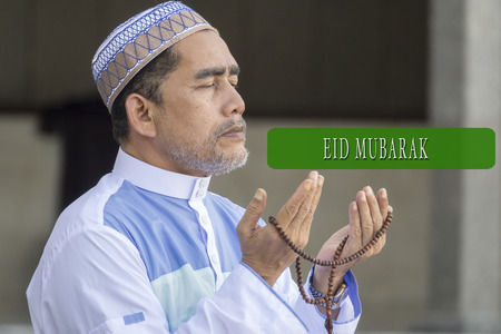 EID MUBARAK concepts word with background of muslim model.