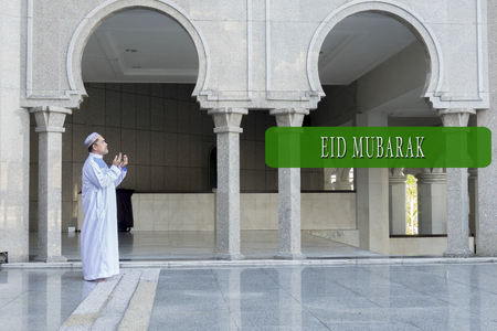 sacrifices: EID MUBARAK concepts word with background of muslim model.