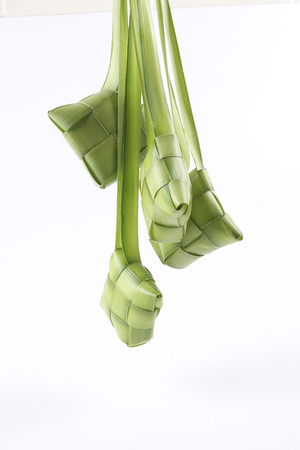 Making of Ketupat, a natural rice casing made from young coconut leaves for cooking rice Foto de archivo