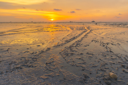 Scenery of sunset captured at Pantai Remis, Selangor, Malaysia. The motion of cloud and water is due to long exposure effect. Low light Stock Photo