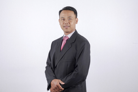 smartness: Young good looking asian business man on a white background isolated Stock Photo