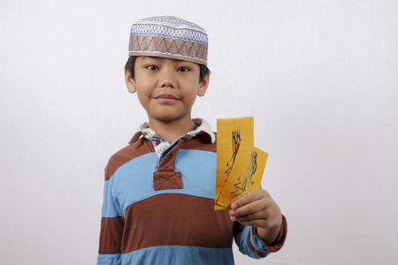 Boy holding money paket for Eid Mubarak. Stock Photo