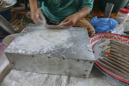 Traditional making Lekor, a traditional food that is popular in East Coast Malaysia. Blurred image