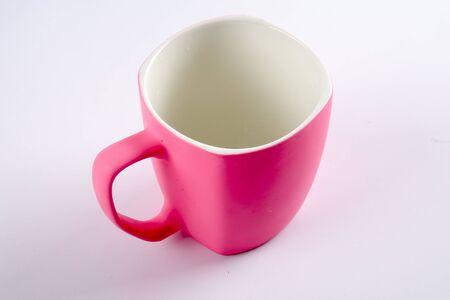 Empty pink mug isoleted on white. Stock Photo