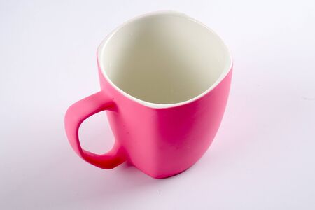 sugar cube: Empty pink mug isoleted on white. Stock Photo
