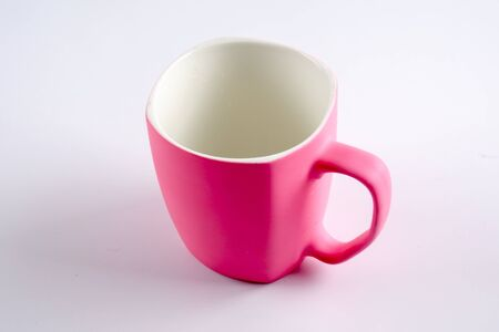 Empty pink mug isoleted on white. Stock Photo