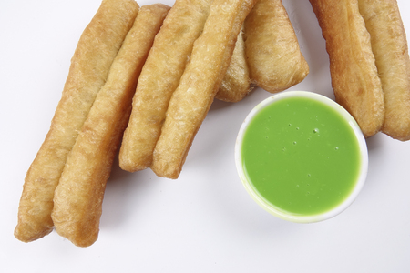 Fried bread stick with coconut jam, the bread is also popularly known as Youtiao and Cakoi, a popular Chinese cuisine. The bread is also popular is Southeast Asian countries.