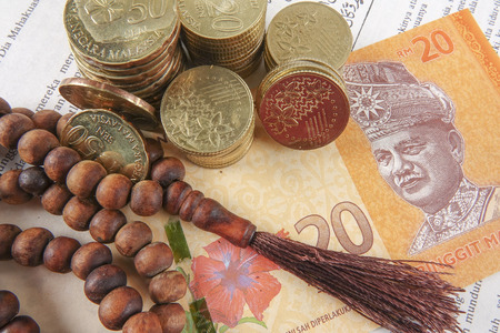 Rosary and coins. Islamic BankingFinance concept.