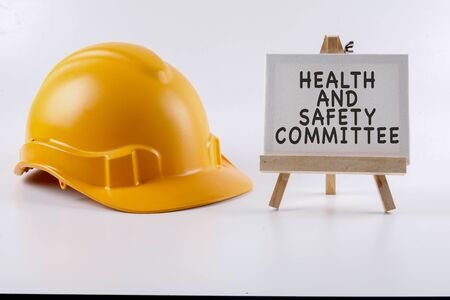 Yellow hardhat safety helmet on white background. Industrial safety and health conceptual. Zdjęcie Seryjne