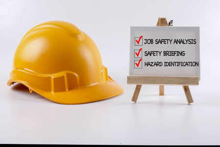 Yellow hardhat safety helmet on white background. Industrial safety and health conceptual. Foto de archivo