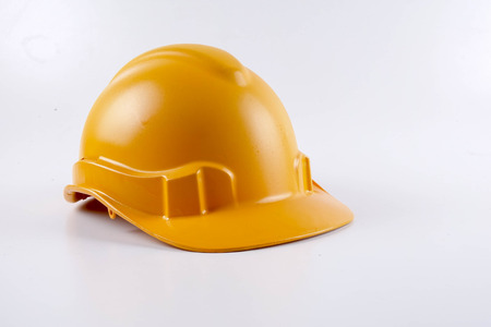 Yellow hardhat safety helmet on white background