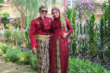 Traditional javanese wedding couple bride and bridegroom at garden Stock Photo