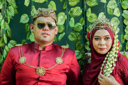 Traditional javanese wedding couple bride and bridegroom at garden Stock Photo