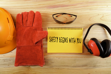 Standard construction safety equipment with SAFETY BEGINS WITH YOU words. Reklamní fotografie