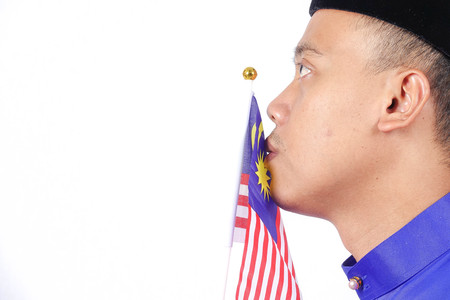 Asian young man with Malaysia flag for National Day celebration. Stock Photo