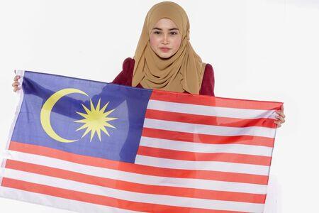 Young beutiful lady holds Malaysia flag isoleted on whitebackground.