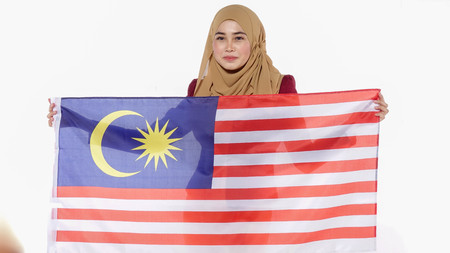 Young beutiful lady holds Malaysia flag isoleted on whitebackground.