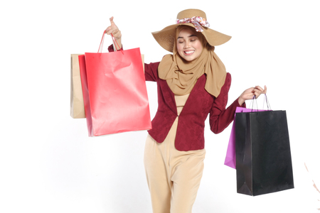 Portrait of a beautiful young muslim woman with shopping bags Reklamní fotografie