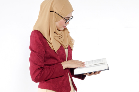 Asian pretty teacher holding blue book isolate on white. Stock Photo