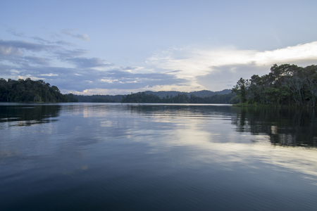 View of man-made lake of Royal Belum with nice green scenery and stumped wood. Stock Photo