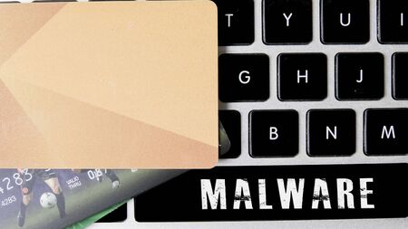Internet security concept with card and black keyboard. Foto de archivo