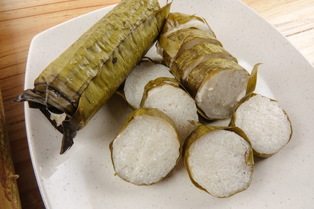 Lemang is a traditional Indonesian, Malaysian, Singaporean food and made of glutinous rice, coconut milk and salt, and cooked in a bamboo stick. Stock Photo - 85067736