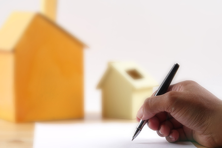 Housing concept agreementtenancy agreementproperty purchase. Blurry background. Stock Photo