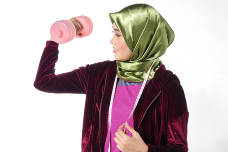 Young pretty asian girl exercise with dumbell and measuring tape. Diet healthy concept. Stock Photo