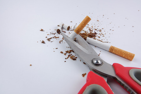 cigarettes and scissor isolated on white. Anti smoking concept