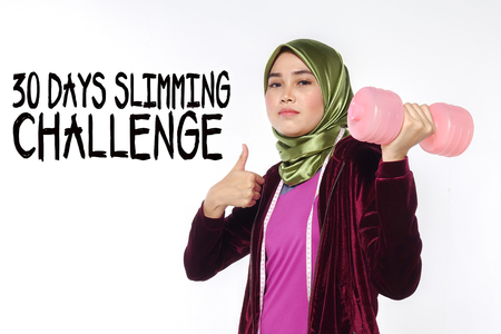 Young pretty asian girl exercise with dumbell and measuring tape with 30DAYS SLIMMING CHALLENGE words. Diet healthy concept.