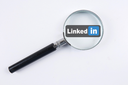 KUALA LUMPUR, 10 DECEMBER 2017. Magnify glass and LINKED IN text. LinkedIn is a social network for search and establishment of business contacts. It is founded in 2002. Editorial