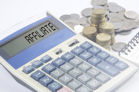 Coins and calculator with business and finance conceptual text.