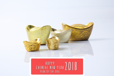 Chinese new year festival decorations,   gold ingots  isolated on white. Chinese characters means luck,wealth and prosperity. HAPPPY CHINESE NEW YEAR 2018