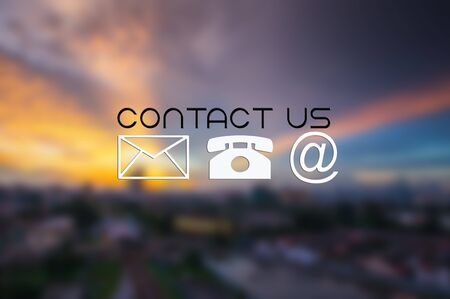 CONTACT US and icons with blurred city scapes background.