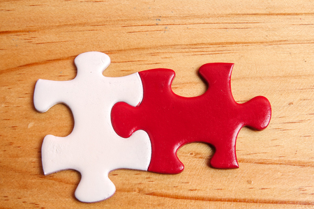 Missing jigsaw puzzle on wooden table. Copy Space