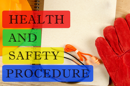HEALTH AND SAFETY PROCEDURE CONCEPT: Safety hat,glove,glasses,ear plugs and note book.