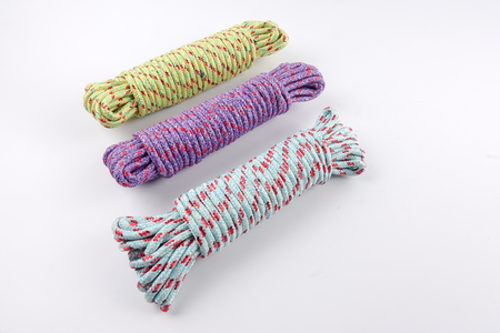 Various colour of ropes isolated on white background. Stock Photo