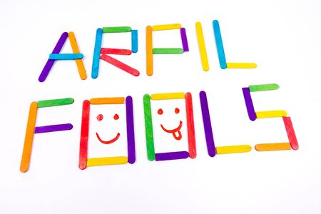 April Fools  background with colourful sticks on white background