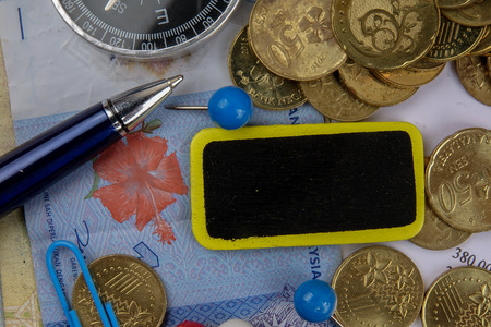 TAX CONCEPT. Coins,calculator,bank notes and wood plate on a white table. Stock fotó