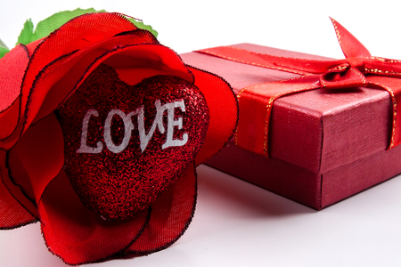 LOVE CONCEPT. Rose and gift box with LOVE printied words.
