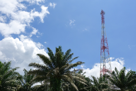 The telecommunication tower in sky with clouds background Stock Photo