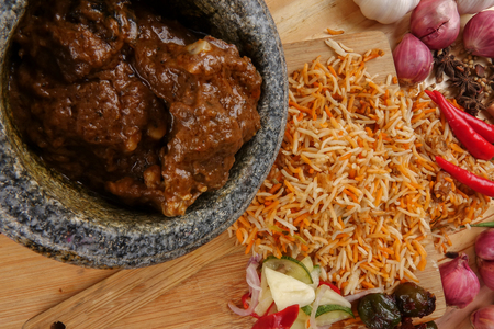 Nasi Briyani is a wholesome rice-based dish prepared with spices, rice, meat and vegetables. Stock Photo - 97159278