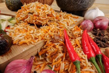 Nasi Briyani is a wholesome rice-based dish prepared with spices, rice, meat and vegetables. Stock Photo